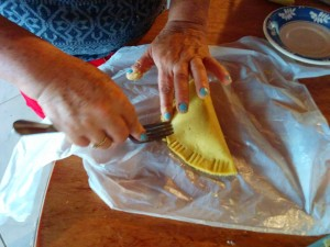 Using a fork to close up the empanada